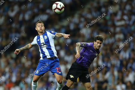 Stock Photo of FC Porto´s Otavio (L) fights for the ball with Pato Rodriguez of Moreirense during their Portuguese First League soccer match held at Dragão Stadium, in Porto, Portugal, 02 September 2018.