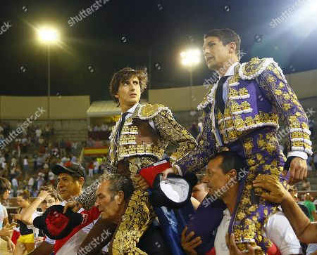 Peruvian bullfighter Roca Rey (L) and Spanish bullfighter Jose Maria Manzanares (R) are carried on their shoulders after their performance at the Santisimo Cristo de los Remedios bullfighting event in San Sebastian de los Reyes, Madrid, Spain, 02 September 2018.