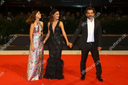 Berenice Bejo, Martina Gusman, Pablo Trapero. Actresses Berenice Bejo, from left, Martina Gusman and director Pablo Trapero pose for photographers at the premiere of the film 'La Quietud' at the 75th edition of the Venice Film Festival in Venice, Italy