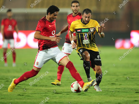 Stock Photo of Al Ahly player Mohamed Nageb (L) in act0in against El Entag El Harby player, Essam El Hadary Mohamed Rageb (R) during the Egyptian league soccer match between Al Ahly and El Entag El Harby at AlSalam Stadium in Cairo, Egypt, 02 September 2018.