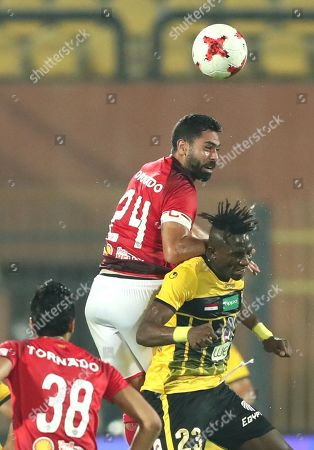Al Ahly player Ahmed fathy (C) in action against El Entag El Harby player Mosa Werara (R) with Al Ahly Akram Tawfik (L) looking on during the Egyptian league soccer match between Al Ahly and El Entag El Harby at AlSalam Stadium in Cairo, Egypt, 02 September 2018.
