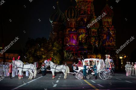 French singer Mireille Mathieu arrives to perform during the closing of the Spasskaya Tower international military music festival in Red Square with the St. Basil's Cathedral in the background, in Moscow, Russia