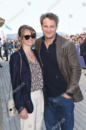 Stock Picture of Jason Clarke and his wife French actress Cecile Breccia pose during the unveiling of his dedicated cabana on the Promenade des Planches