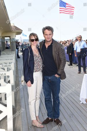 Stock Image of Jason Clarke and his wife French actress Cecile Breccia pose during the unveiling of his dedicated cabana on the Promenade des Planches