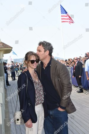 Jason Clarke and his wife French actress Cecile Breccia pose during the unveiling of his dedicated cabana on the Promenade des Planches