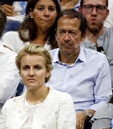 Jenny Paulson, (L) wife of US billionaire hedge fund manager John Paulson (R) watch Elise Mertens of Belgium in action against Sloane Stephens of the USA during the seventh day of the US Open Tennis Championships at the Arthur Ashe Stadium in the USTA National Tennis Center in Flushing Meadows, New York, USA, 02 September 2018. The US Open runs from 27 August through 09 September.
