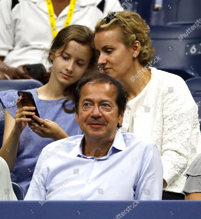 US billionaire hedge fund manager John Paulson (C) and his daughter Giselle (L) and wife Jenny (R) watch Elise Mertens of Belgium in action against Sloane Stephens of the USA during the seventh day of the US Open Tennis Championships at the Arthur Ashe Stadium in the USTA National Tennis Center in Flushing Meadows, New York, USA, 02 September 2018. The US Open runs from 27 August through 09 September.