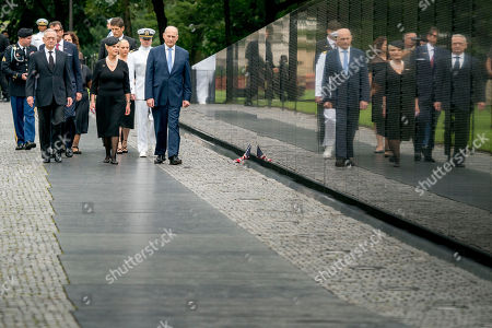Cindy McCain, wife of, Senator John McCain, R-Ariz., accompanied by President Donald Trump's Chief of Staff John Kelly, right, Defense Secretary James Mattis, and family members, arrives at the Vietnam Veterans Memorial in Washington,, during a Funeral procession to carry the casket of her husband from the U.S. Capitol to National Cathedral for a Memorial Service. McCain served as a Navy pilot during the Vietnam War and was a prisoner of war for more than five years.