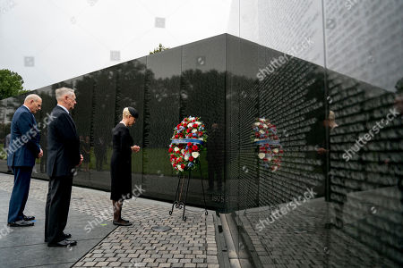 Stock Image of Cindy McCain, wife of, Senator John McCain, R-Ariz., accompanied by President Donald Trump's Chief of Staff John Kelly, left, and Defense Secretary James Mattis, second from left, laying a wreath at the Vietnam Veterans Memorial in Washington,, during a Funeral procession to carry the casket of her husband from the U.S. Capitol to National Cathedral for a Memorial Service. McCain served as a Navy pilot during the Vietnam War and was a prisoner of war for more than five years.