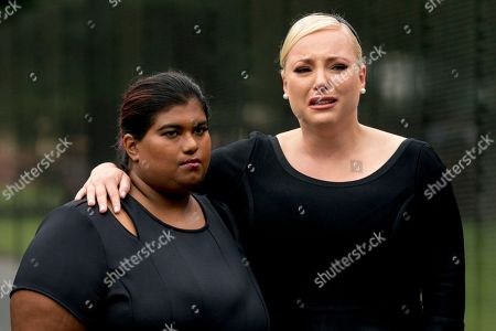 Bridget McCain and Meghan McCain, daughters of Senator John McCain, R-Ariz., watch as Cindy McCain, lays a wreath at the Vietnam Veterans Memorial in Washington,, during a Funeral procession to carry the casket of her husband from the U.S. Capitol to National Cathedral for a Memorial Service. McCain served as a Navy pilot during the Vietnam War and was a prisoner of war for more than five years.