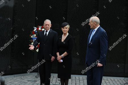 U.S. Secretary of Defense James Mattis, General John Kelly, White House Chief of Staff and Cindy McCain, wife of late Senator John McCain, lay a ceremonial wreath honoring all whose lives were lost during the Vietnam War at at the Vietnam Veterans Memorial in Washington, U.S.,.
