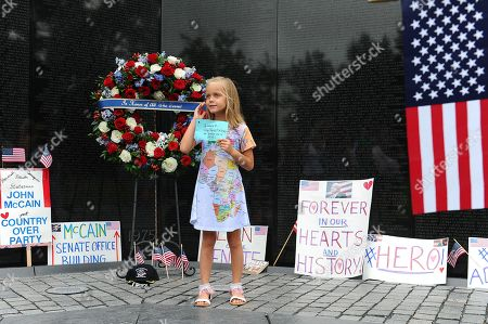 Eliana Duy, 8, FL, stands in front of the wreath that U.S. Secretary of Defense James Mattis, General John Kelly, White House Chief of Staff and Cindy McCain, wife of late Senator John McCain laid