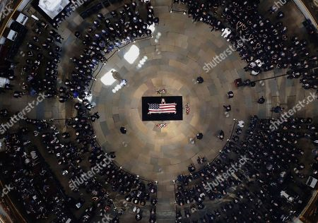 Cindy McCain, wife of the late U.S. Senator John McCain, R-Ariz., stands over his casket as he lies in state in the U.S. Capitol Rotunda, in Washington.