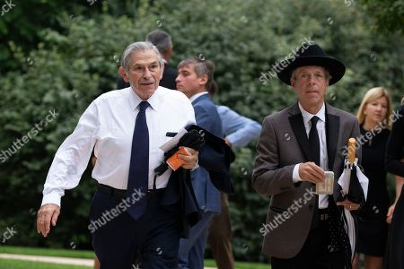 Mark McKinnon, right, and Paul Wolfowitz, former deputy secretary of defense, left, arrive for the funeral service for late United States Senator John McCain (Republican of Arizona) at the Washington National Cathedral in Washington, DC.
