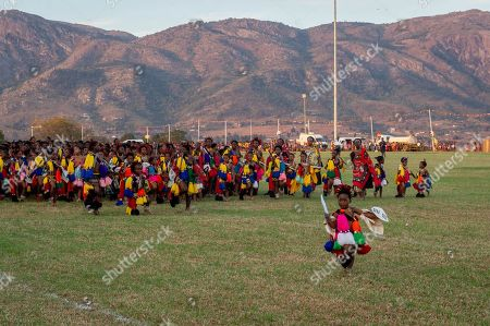 Young women participating in the annual 'Umhlanga', or Reed Dance ceremony, present themselves before the king at the main stadium at the Swazi Royal Residence, with their reeds to be presented to King Mswati III, in Mbabane, Swaziland or eSwatini, 02 September 2018. On the main day of the eight-day event, the young women gather in their groups according to where they live and present the reeds to the Queen Mother and King Mswati III as a rite of passage.