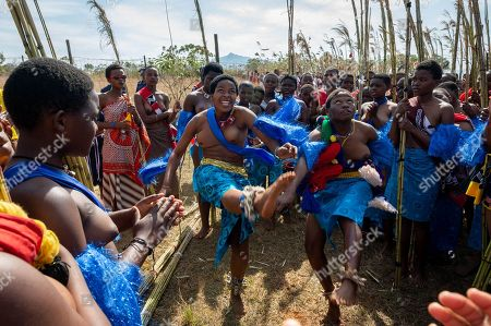 Young women participating in the annual 'Umhlanga', or Reed Dance ceremony, dance before moving toward the main stadium at the Swazi Royal Residence, with their reeds to be presented to King Mswati III, in Mbabane, Swaziland or eSwatini, 02 September 2018. On the main day of the eight-day event, the young women gather in their groups according to where they live and present the reeds to the Queen Mother and King Mswati III as a rite of passage.