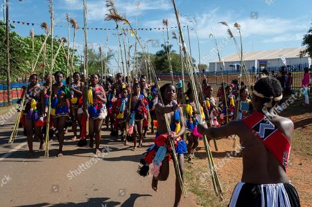 A young girl participating in the annual 'Umhlanga', or Reed Dance ceremony, takes a photograph of her group as they march towards the main stadium at the Swazi Royal Residence with their reeds to be presented to King Mswati III, in Mbabane, Swaziland or eSwatini, 02 September 2018. On the main day of the eight-day event, the young women gather in their groups according to where they live and present the reeds to the Queen Mother and King Mswati III as a rite of passage.