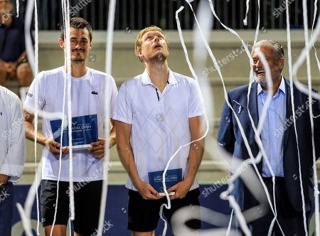 Australian tennis player Bernard Tomic (L) celebrates his victory in the Rafa Nadal Banc Sabadell Tournament after beating German Matthias Bachinger (C) at Rafa Nadal Academy in Manacor, Spain, 02 September 2018 (issued 03 September 2018).