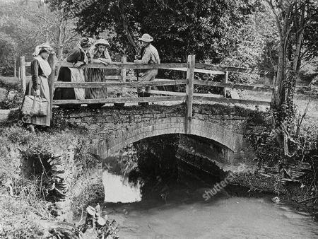 Villagers Chatting On A Little Stone Bridge Over A Stream 1890s. Photograph by Graystone Bird, of Bath