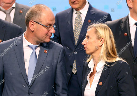 European Commissioner for Education, Tibor Navracsics, left, talks with Austrian Minister for Women, Families and Youth, Juliane Bogner-Strauss, right, during an informal meeting of youth ministers in Vienna, Austria