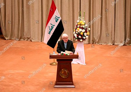 Iraqi President Fuad Masum addresses a newly elected parliament during its first session in Baghdad, Iraq, . Iraq's newly elected parliament held its first session as two blocs, both claiming to hold the most seats, vied for the right to form a new government