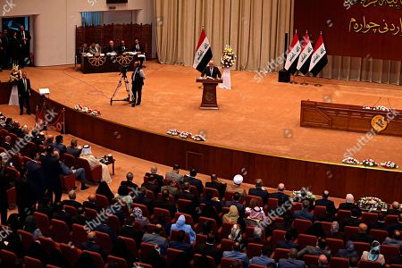 Iraq Prime Minister Haider al-Abadi, center, addresses a newly elected parliament during its first session in Baghdad, Iraq, . Iraq's newly elected parliament held its first session as two blocs, both claiming to hold the most seats, vied for the right to form a new government