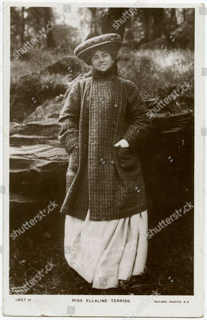 Ellaline Terriss (1871 - 1971) English Actress and Singer Wears A Large Tweed Flat Cap & A Double-breasted Striped Woollen 3/4 Length Coat with High Stand Collar & Large Patch Pockets. Photographic Postcard by Foulsham & Banfield