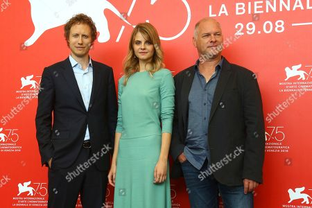Laszlo Nemes, Juli Jakab, Vlad Ivanov. Director Laszlo Nemes, from left, actors Juli Jakab and Vlad Ivanov pose for photographers at the photo call for the film 'Sunset' at the 75th edition of the Venice Film Festival in Venice, Italy
