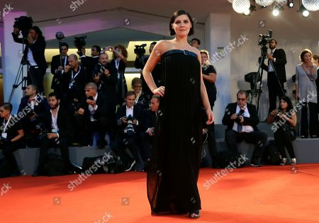 Actress Annabel Scholey poses for photographers upon arrival at the premiere of the film ' The Sisters Brothers' at the 75th edition of the Venice Film Festival in Venice, Italy