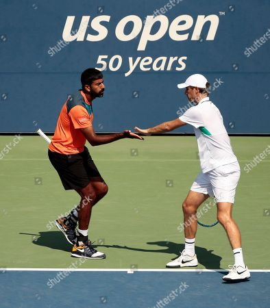 Rohan Bopanna, of India, and Edouard Roger-Vasselin, of France celebrate after a point against Jeremy Chardy and Fabrice Martin, of France during during a doubles match at the U.S. Open tennis tournament, in New York