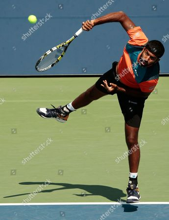 Rohan Bopanna, of India, serves to Jeremy Chardy and Fabrice Martin, of France during doubles match at the U.S. Open tennis tournament, in New York. Bopanna doubles partner is Edouard Roger-Vasselin, of France