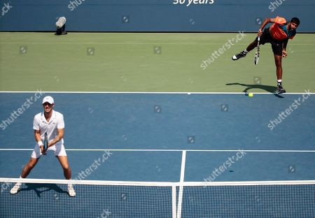 Rohan Bopanna, of India, serves to Jeremy Chardy and Fabrice Martin, of France during during a doubles match at the U.S. Open tennis tournament, in New York. Bopanna doubles partner is Edouard Roger-Vasselin, of France