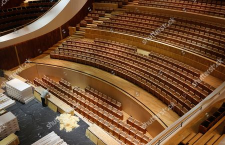 A worker examines convertible seats systems in the Great Hall of the Moscow Concert Hall 'Zaryadye' in the new park, built in the historic center of the city, next to the Kremlin and Red Square in Moscow, Russia, 03 September 2018. New concert hall designed for 1600 seats. A famous Japanese specialist, director of 'Nagata Acoustics' company Yasuhisa Toyota, was drafted for create acoustics in the Moscow concert hall 'Zaryadye'. The rows of the stalls of the Great Hall will be able to both rise to a height of 2.5 meters, and fully fold, turning the auditorium into an flat area. In the summer of 2018 began installation of the musical wind instrument keyboard organ created by the French firm Muhleisen in Strasbourg. By the number of registers it will be the biggest tool in the capital and one of the largest in Europe.
