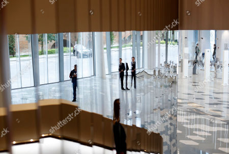People are reflected in the mirrors inside the newly built Moscow Concert Hall 'Zaryadye' in the new park, built in the historic center of the city, next to the Kremlin and Red Square in Moscow, Russia, 03 September 2018. New concert hall designed for 1600 seats. A famous Japanese specialist, director of 'Nagata Acoustics' company Yasuhisa Toyota, was drafted for create acoustics in the Moscow concert hall 'Zaryadye'. The rows of the stalls of the Great Hall will be able to both rise to a height of 2.5 meters, and fully fold, turning the auditorium into an flat area. In the summer of 2018 began installation of the musical wind instrument keyboard organ created by the French firm Muhleisen in Strasbourg. By the number of registers it will be the biggest tool in the capital and one of the largest in Europe.