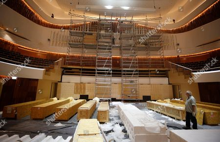 French workers install the keyboard organ created by the French firm Muhleisen in Strasbourg in the Great Hall of the newly built Moscow Concert Hall 'Zaryadye' in the new park, built in the historic center of the city, next to the Kremlin and Red Square in Moscow, Russia, 03 September 2018. New concert hall designed for 1600 seats. A famous Japanese specialist, director of 'Nagata Acoustics' company Yasuhisa Toyota, was drafted for create acoustics in the Moscow concert hall 'Zaryadye'. The rows of the stalls of the Great Hall will be able to both rise to a height of 2.5 meters, and fully fold, turning the auditorium into an flat area. In the summer of 2018 began installation of the musical wind instrument keyboard organ created by the French firm Muhleisen in Strasbourg. By the number of registers it will be the biggest tool in the capital and one of the largest in Europe.