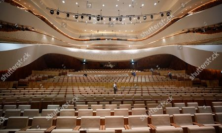 A worker walks between the rows of the seats in the Great Hall of the Moscow Concert Hall 'Zaryadye' in the new park, built in the historic center of the city, next to the Kremlin and Red Square in Moscow, Russia, 03 September 2018.  New concert hall designed for 1600 seats. A famous Japanese specialist, director of 'Nagata Acoustics' company Yasuhisa Toyota, was drafted for create acoustics in the Moscow concert hall 'Zaryadye'. The rows of the stalls of the Great Hall will be able to both rise to a height of 2.5 meters, and fully fold, turning the auditorium into an flat area. In the summer of 2018 began installation of the musical wind instrument keyboard organ created by the French firm Muhleisen in Strasbourg. By the number of registers it will be the biggest tool in the capital and one of the largest in Europe.