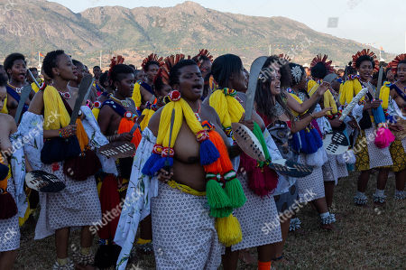 Young women dance during the annual 'Umhlanga', or Reed Dance ceremony at the Swazi Royal Residence after being presented to King Mswati III, Mbabane, Swaziland, 03 September 2018. On the main day of the eight-day event, the young women gather in their groups according to where they live and present the reeds to the Queen Mother and King Mswati III as a rite of passage.