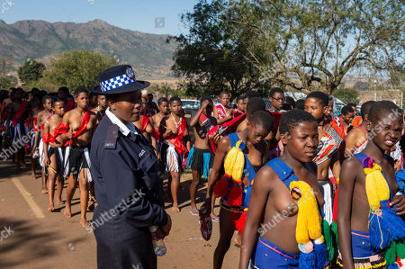 Young women taking part in the annual 'Umhlanga', or Reed Dance ceremony, march towards the main stadium at the Swazi Royal Residence with their reeds to be presented to King Mswati III, Mbabane, Swaziland, 03 September 2018. On the main day of the eight-day event, the young women gather in their groups according to where they live and present the reeds to the Queen Mother and King Mswati III as a rite of passage.