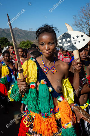 A young woman participating in the annual 'Umhlanga', or Reed Dance ceremony, stands for a portrait before marching towards the main stadium at the Swazi Royal Residence with their reeds to be presented to King Mswati III, Mbabane, Swaziland, 02 September 2018. On the main day of the eight-day event, the young women gather in their groups according to where they live and present the reeds to the Queen Mother and King Mswati III as a rite of passage.