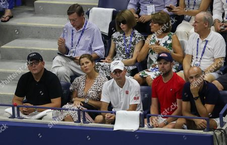 A view of Roger Federer Player's Box, as Anna Wintour sits with Lynette Federer, mother of Roger Federer, and Mirka sits with his coaching team in front