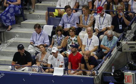 Stock Image of A view of Roger Federer Player's Box, as Anna Wintour sits with Lynette Federer, mother of Roger Federer, and Mirka sits with his coaching team in front
