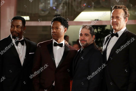 Actor Michael Jai White, left, actor Tory Kittles, second left, director S. Craig Zahler, second right, and actor Vince Vaughn, right, pose for photographers upon arrival at the premiere of the film 'Dragged Across Concrete' at the 75th edition of the Venice Film Festival in Venice, Italy