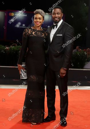 Actor Michael Jai White and Gillian Iliana Waters pose for photographers upon arrival at the premiere of the film 'Dragged Across Concrete' at the 75th edition of the Venice Film Festival in Venice, Italy