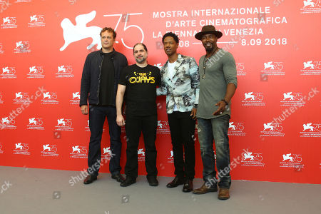 Vince Vaughn, from left, S. Craig Zahler and actors Tory Kittles, Michael Jai White pose for photographers at the photo call for the film 'Dragged Across Concrete' at the 75th edition of the Venice Film Festival in Venice, Italy