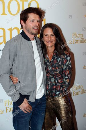 """Pierre Deladonchamps, left, and Camille Cottin attend a photo call for the premiere of """"Photo de Famille"""" in Paris"""