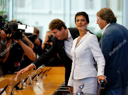 Stock Image of Sahra Wagenknecht (2-R), chairwoman of the parliamentary group of The Left (Die Linke) party in the German 'Bundestag' parliament, Ludger Volmer (R), former chairman of The Greens party, and Bernd Stegemann (3-R), author and dramatic adviser, take their seats at the beginning of the founding press conference of the movement 'Get Up' (Aufstehen) in Berlin, Germany, 04 September 2018. 'Get up' aims at gathering supporters of different parties in a common movement and to promote campaigns for left-wing political goals.