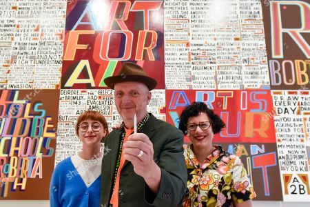 Stock Image of Celebrated artist Bob and Roberta Smith RA (C), poses with his daughter Etta Voorsanger (L) and wife Jessica Voorsanger (R) at the unveiling of his new work