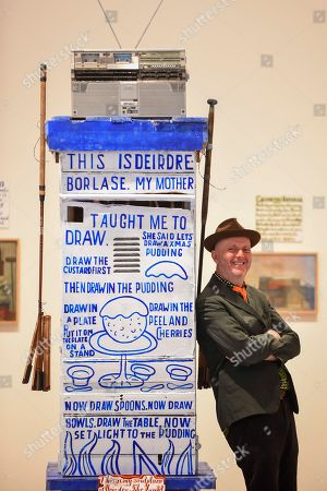 Celebrated artist Bob and Roberta Smith RA, poses with his new work