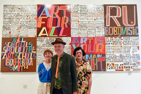 Stock Photo of Celebrated artist Bob and Roberta Smith RA (C), poses with his daughter Etta Voorsanger (L) and wife Jessica Voorsanger (R) at the unveiling of his new work