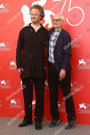 Florian Henckel von Donnersmack, Caleb Deschanel. Director Florian Henckel von Donnersmack, left, and cinematographer Caleb Deschanel poses for photographers at the photo call for the film 'Never Look Away' at the 75th edition of the Venice Film Festival in Venice, Italy